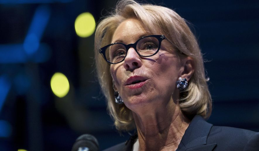 In this Sept. 17, 2018 file photo, Education Secretary Betsy DeVos speaks during a student town hall at National Constitution Center in Philadelphia. DeVos is proposing a major overhaul to the way colleges handle complaints of sexual misconduct. (AP Photo/Matt Rourke) ** FILE **