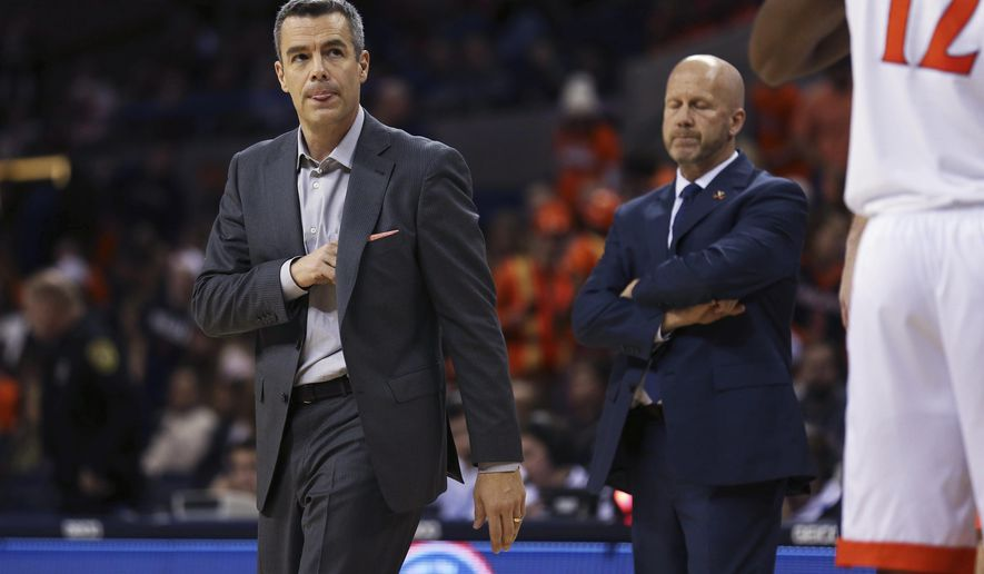 Virginia coach Tony Bennett walks to his team during a break in play in the first half against Coppin State in an NCAA college basketball game Friday, Nov. 16, 2018, in Charlottesville, Va. (Zack Wajsgras/The Daily Progress via AP)