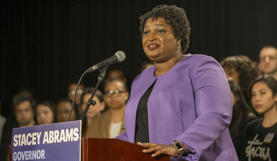 "Georgia gubernatorial candidate Stacey Abrams makes remarks during a press conference at the Abrams Headquarters in Atlanta, Friday, Nov. 16, 2018. Democrat Stacey Abrams says she will file a federal lawsuit to challenge the ""gross mismanagement"" of Georgia elections. Abrams made the comments in a Friday speech, shortly after she said she can't win the race, effectively ending her challenge to Republican Brian Kemp. (Alyssa Pointer/Atlanta Journal-Constitution via AP)"