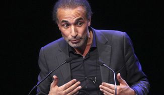 FILE - In this Feb. 7, 2016 file photo, Muslim scholar Tariq Ramadan delivers a speech during a French Muslim organizations meeting in Lille, northern France. The lawyer representing an accuser of prominent Islamic scholar Tariq Ramadan, who was jailed in February amid an investigation into two alleged cases of rape, says he has been released on bail. (AP Photo/Michel Spingler, File)