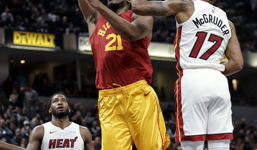 Indiana Pacers forward Thaddeus Young (21) goes to the basket in front of Miami Heat forward Rodney McGruder (17) during the second half of an NBA basketball game in Indianapolis, Friday, Nov. 16, 2018. (AP Photo/AJ Mast)