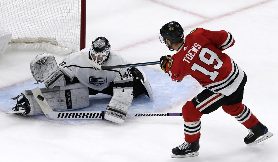 Los Angeles Kings goalie Calvin Petersen, left, blocks a shot by Chicago Blackhawks center Jonathan Toews  (19) in a shootout of an NHL hockey game Friday, Nov. 16, 2018, in Chicago. (AP Photo/Nam Y. Huh)