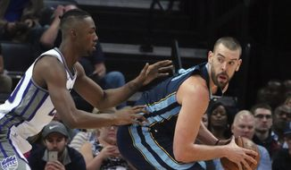 Memphis Grizzlies' Marc Gasol (33) looks to pass while guarded by Sacramento Kings' Harry Giles lll during the first half of an NBA basketball game Friday, Nov. 16, 2018, in Memphis, Tenn. (AP Photo/Karen Pulfer Focht)