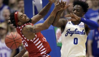 Louisiana Lafayette forward JaKeenan Gant, left, tries to rebound against Kansas guard Marcus Garrett (0) during the first half of an NCAA college basketball game in Lawrence, Kan., Friday, Nov. 16, 2018. (AP Photo/Orlin Wagner)
