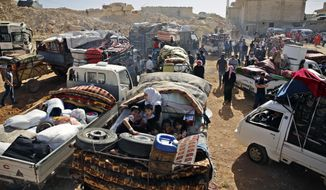 FILE - This Thursday, June 28, 2018, file photo, Syrian refugees gather in their vehicles getting ready to cross into Syria from the eastern Lebanese border town of Arsal, Lebanon. The Russian military said Friday, Nov. 16, 2018 that nearly 270,000 Syrian refugees have returned home from exile in recent months, including 6,000 in the last week alone. (AP Photo/Bilal Hussein, File)