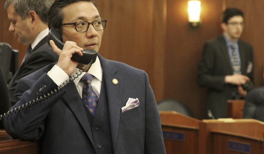 FILE - This Jan. 16, 2018, photo shows Alaska state Rep. Scott Kawasaki, a Fairbanks Democrat, talking on a telephone before the start of the legislative session at the state Capitol in Juneau, Alaska. Republican Alaska Senate President Pete Kelly appears to have lost his re-election bid but told The Associated Press that he's leaving open the option of a recount. Ballots tallied Friday, Nov. 16, 2018, show Kawasaki widening his lead to 173 votes in the Fairbanks race. (AP Photo/Mark Thiessen, File)