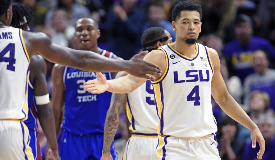 LSU forward Emmitt Williams, left, celebrates with teammate Skylar Mays (4) late in the second half of an NCAA college basketball game, Friday, Nov. 16, 2018, in Baton Rouge, La. LSU won 74-67. (AP Photo/Bill Feig)