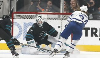 Toronto Maple Leafs right wing Kasperi Kapanen (24), of Finland, scores a goal past San Jose Sharks goaltender Martin Jones (31) during the first period of an NHL hockey game in San Jose, Calif., Thursday, Nov. 15, 2018. (AP Photo/Tony Avelar)