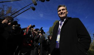 CNN's Jim Acosta speaks to journalists on the North Lawn upon returning back to the White House in Washington, Friday, Nov. 16, 2018. (AP Photo/Manuel Balce Ceneta)