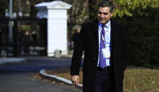CNN's Jim Acosta walks on the North Lawn driveway upon returning back to the White House in Washington, Friday, Nov. 16, 2018. Judge asked the White House to immediately return press credentials of Jim Acosta. (AP Photo/Manuel Balce Ceneta)