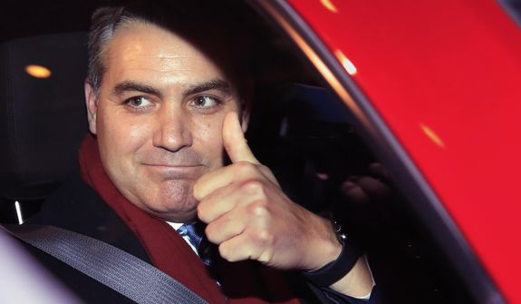 """CNN's Jim Acosta gestures as he leaves federal court in Washington, Wednesday, Nov. 14, 2018, following a hearing on a legal challenge against President Donald Trump's administration over the revocation of his White House """"hard pass."""" (AP Photo/Manuel Balce Ceneta)"""