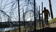 Members of the U.S. military install concertina wire along the banks of the Rio Grande near the Juarez-Lincoln Bridge at the U.S.-Mexico border, Friday, Nov. 16, 2018, in Laredo, Texas. (AP Photo/Eric Gay)