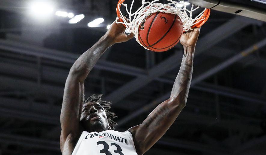 Cincinnati's Nysier Brooks dunks during the first half of the team's NCAA college basketball game against Milwaukee, Friday, Nov. 16, 2018, in Cincinnati. (AP Photo/John Minchillo)
