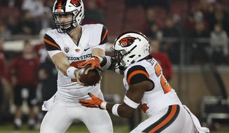 Oregon State quarterback Jake Luton (6) hands off to Oregon State running back Jermar Jefferson (22) against Stanford in the first half during an NCAA college football game on Saturday, Nov. 10, 2018, in Stanford, Calif. (AP Photo/Tony Avelar)