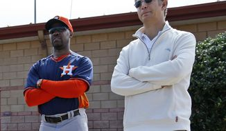 FILE - In this Feb. 25, 2014, file photo, Houston Astros manager Bo Porter, left, and scouting director Mike Elias stand during a spring training baseball workout in Viera, Fla. Elias has been hired to rebuild the Baltimore Orioles, who traded many of their star players last season before finishing with the worst record in the majors.  He comes to Baltimore after working as scouting director and assistant general manager in Houston, where he helped transform a last-place team into 2017 World Series champions.  (AP Photo/Alex Brandon, File)