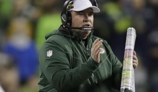 Green Bay Packers coach Mike McCarthy calls to his team during the first half of an NFL football game against the Seattle Seahawks, Thursday, Nov. 15, 2018, in Seattle. (AP Photo/Stephen Brashear)