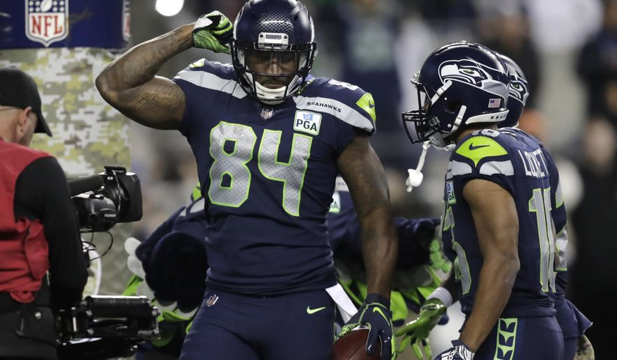 Seattle Seahawks tight end Ed Dickson (84) celebrates after scoring a touchdown against the Green Bay Packers during the second half of an NFL football game Thursday, Nov. 15, 2018, in Seattle. (AP Photo/Stephen Brashear)