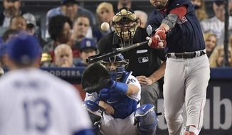 FILE - In this Oct. 28, 2018, file photo, Boston Red Sox's Steve Pearce, right, hits a home run against the Los Angeles Dodgers during the eighth inning in Game 5 of the World Series baseball game in Los Angeles. The Red Sox have re-signed Pearce to a one-year deal worth $6.25 million. Boston announced the agreement on Friday, Nov. 16, 2018. (AP Photo/Mark J. Terrill, File)