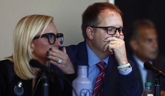 Florida Senator Lauren Book, left, and Ryan Petty, the father of shooting victim Alaina Petty listen to videos from the school shooting during the Marjory Stoneman Douglas High School Public Safety Commission meeting Thursday, Nov. 15, 2018, in Sunrise, Fla. (AP Photo/Brynn Anderson)