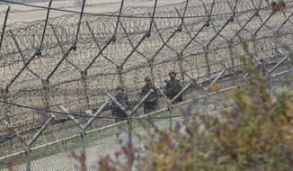"""South Korean army soldiers patrol along the barbed-wire fence in Paju, South Korea, near the border with North Korea, Friday, Nov. 16, 2018. North Korean leader Kim Jong Un observed the successful test of """"a newly developed ultramodern tactical weapon,"""" the nation's state media reported Friday, though it didn't describe what sort of weapon it was.(AP Photo/Ahn Young-joon)"""