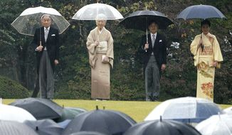 In this Nov. 9, 2018, file photo, Japan's Emperor Akihito, left, Empress Michiko, second from left, Crown Prince Naruhito, second from right, and Crown Princess Masako, right, greet the guests during the autumn garden party at the Akasaka Palace imperial garden in Tokyo. (AP Photo/Eugene Hoshiko, File)