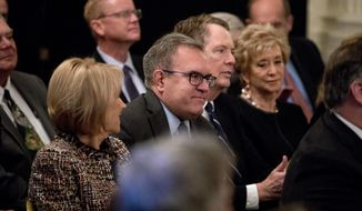 EPA acting Administrator Andrew Wheeler, smiles as he is recognized by President Donald Trump during a Medal of Freedom ceremony in the East Room of the White House in Washington, Friday, Nov. 16, 2018. Also pictured is Education Secretary Betsy DeVos, left, and U.S. Trade Representative Robert Lighthizer, second from right. Wheeler, a former congressional aide and lobbyist who has led the EPA since his scandal-plagued predecessor resigned earlier this year, got Trump's nod for the permanent job. Trump made the announcement in passing at a White House ceremony for Presidential Medal of Freedom honorees. (AP Photo/Andrew Harnik)