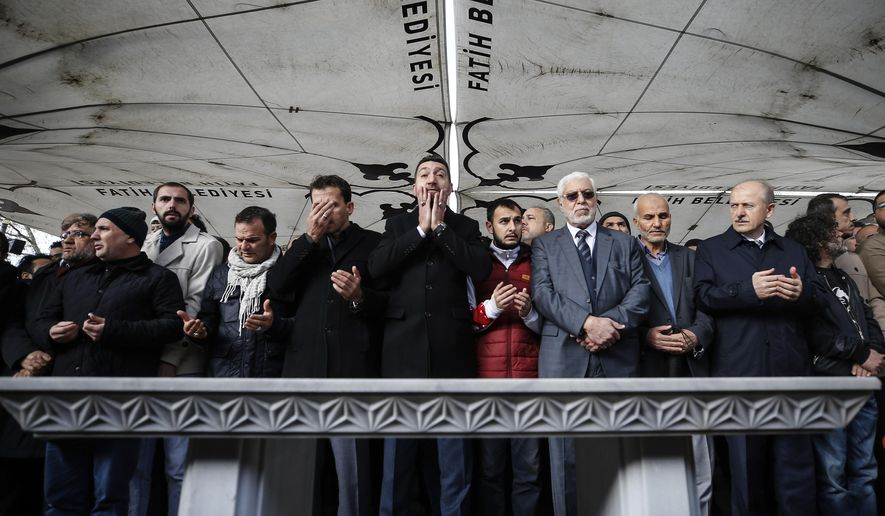 The members of Arab-Turkish Media Association and friends attend funeral prayers in absentia for Saudi writer Jamal Khashoggi who was killed last month in the Saudi Arabia consulate, in Istanbul, Friday, Nov. 16, 2018. Turkey's Foreign Minister Mevlut Cavusoglu on Thursday called for an international investigation into the killing of the Saudi dissident Jamal Khashoggi. (AP Photo/Emrah Gurel)
