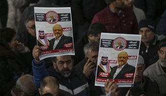The members of Arab-Turkish Media Association and friends hold posters as they attend funeral prayers in absentia for Saudi writer Jamal Khashoggi who was killed last month in the Saudi Arabia consulate, in Istanbul, Friday, Nov. 16, 2018. Turkey's Foreign Minister Mevlut Cavusoglu on Thursday called for an international investigation into the killing of the Saudi dissident writer Jamal Khashoggi.(AP Photo/Emrah Gurel)
