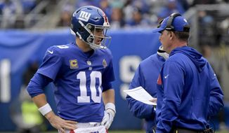 In this Oct. 28, 2018, file photo, New York Giants quarterback Eli Manning (10) talks with head coach Pat Shurmur during the second quarter of an NFL football game in East Rutherford, N.J. When things go sour, an NFL team's fan base often points to two people: the guy calling plays on the sideline, and the man behind center trying to execute them. (AP Photo/Bill Kostroun, File) **FILE**