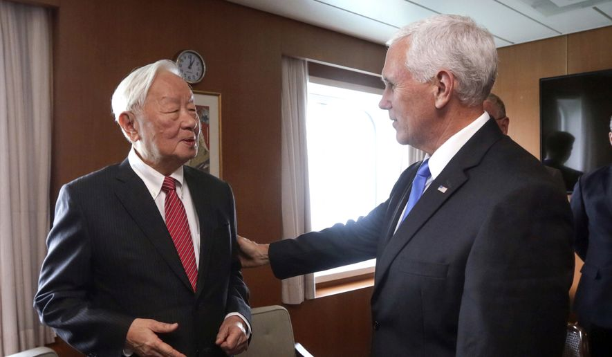 In this photo released by Taiwan's Ministry of Foreign Affairs, Taiwan's special APEC envoy Morris Chang, left, meets with U.S. Vice President Mike Pence on the Pacific Explorer cruise ship on the sidelines of the APEC Summit, Saturday, Nov. 17, 2018, in Port Moresby, Papua New Guinea. (Taiwan Ministry of Foreign Affairs via AP) **FILE**