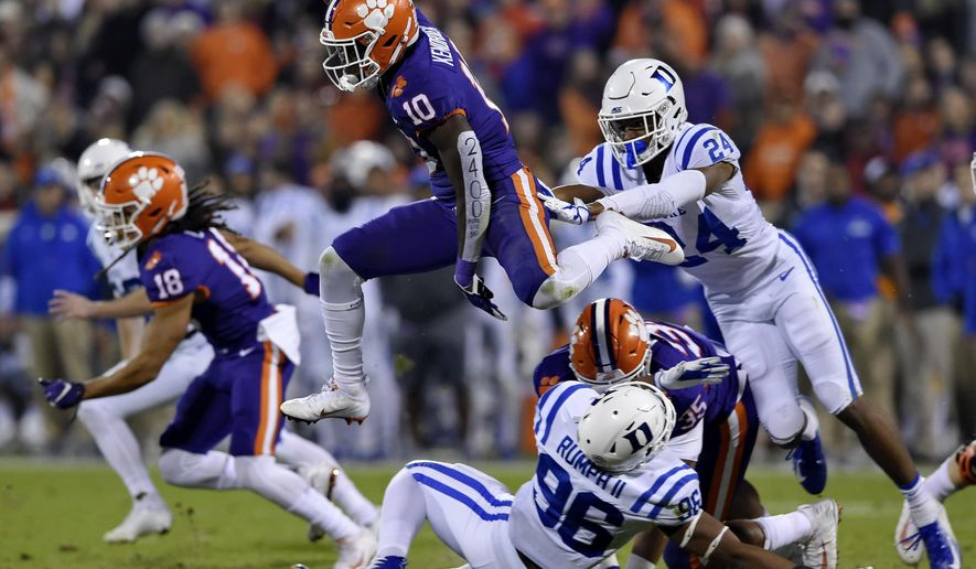 Clemson's Derion Kendrick (10) hurdles Duke's Chris Rumph ll (96) on a kickoff return as Jarrett Garner reaches for him during the first half of an NCAA college football game Saturday, Nov. 17, 2018, in Clemson, S.C. (AP Photo/Richard Shiro)