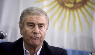Argentina's Defense Minister Oscar Aguad attends a press conference in Buenos Aires, Argentina, Saturday, Nov. 17, 2018. Argentina's navy announced early Saturday that they have located the missing submarine ARA San Juan in the Atlantic, a year after it disappeared with 44 crew members aboard.(AP Photo/Pablo Stefanec)
