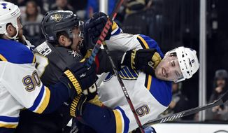 Vegas Golden Knights left wing William Carrier (28) punches St. Louis Blues defenseman Joel Edmundson (6) during a scuffle in the second period of an NHL hockey game Friday, Nov. 16, 2018, in Las Vegas. (AP Photo/David Becker)
