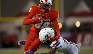 New Mexico tight end Marcus Williams (88) is tackled by Boise State cornerback Tyler Horton during the first half of an NCAA college football game in Albuquerque, N.M., Friday, Nov. 16, 2018. (AP Photo/Andres Leighton)