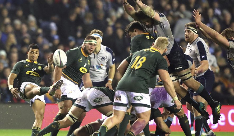 South Africa's Embrose Papier, left, kicks the ball during the rugby union international match between Scotland and South Africa at Murrayfield stadium, in Edinburgh, Scotland, Saturday, Nov. 17, 2018. (AP Photo/Scott Heppell)