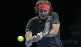 Alexander Zverev of Germany plays a return to Roger Federer of Switzerland in their ATP World Tour Finals singles tennis match at the O2 Arena in London, Saturday Nov. 17, 2018. (AP Photo/Tim Ireland)