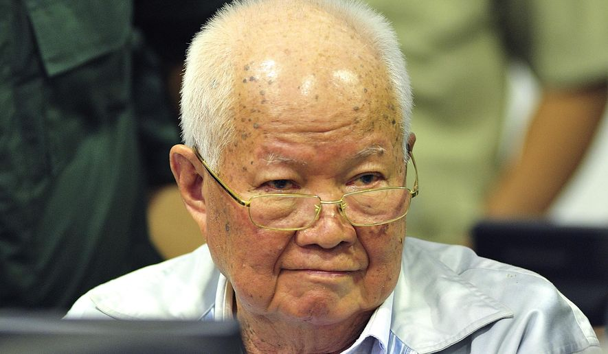 In this photo released by the Extraordinary Chambers in the Courts of Cambodia, Khieu Samphan, former Khmer Rouge head of state, sits in a court room before a hearing at the U.N.-backed war crimes tribunal in Phnom Penh, Cambodia, Friday, Nov. 16, 2018. The international tribunal to judge the criminal responsibility of former Khmer Rouge leaders for the deaths of an estimated 1.7 million Cambodians opened its session Friday to deliver its verdicts on charges of genocide and other crimes. (Mark Peters/Extraordinary Chambers in the Courts of Cambodia via AP)