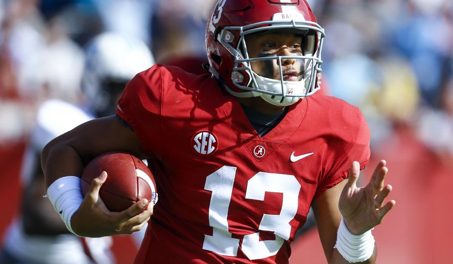 Alabama quarterback Tua Tagovailoa (13) carries the ball during the first half of an NCAA college football game against Citadel, Saturday, Nov. 17, 2018, in Tuscaloosa, Ala. (AP Photo/Butch Dill)