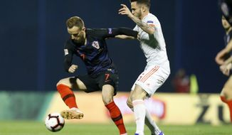 Croatia's Ivan Rakitic, left, challenges for the ball with with Spain's Saul Niguez during the UEFA Nations League soccer match between Croatia and Spain at the Maksimir stadium in Zagreb, Croatia, Thursday, Nov. 15, 2018. (AP Photo/Darko Bandic)