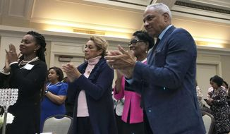 Mississippi Democratic Senate candidate Mike Espy applauds U.S. Sen. Kamala Harris, a California Democrat and possible 2020 presidential candidate, during an event Saturday, Nov. 17, 2018 in Jackson, Miss. Harris traveled to Mississippi to support Espy, who faces Republican Cindy Hyde-Smith in a Nov. 27 runoff for the remaining two years on a six-year U.S. Senate term. (AP Photo/Jeff Amy)