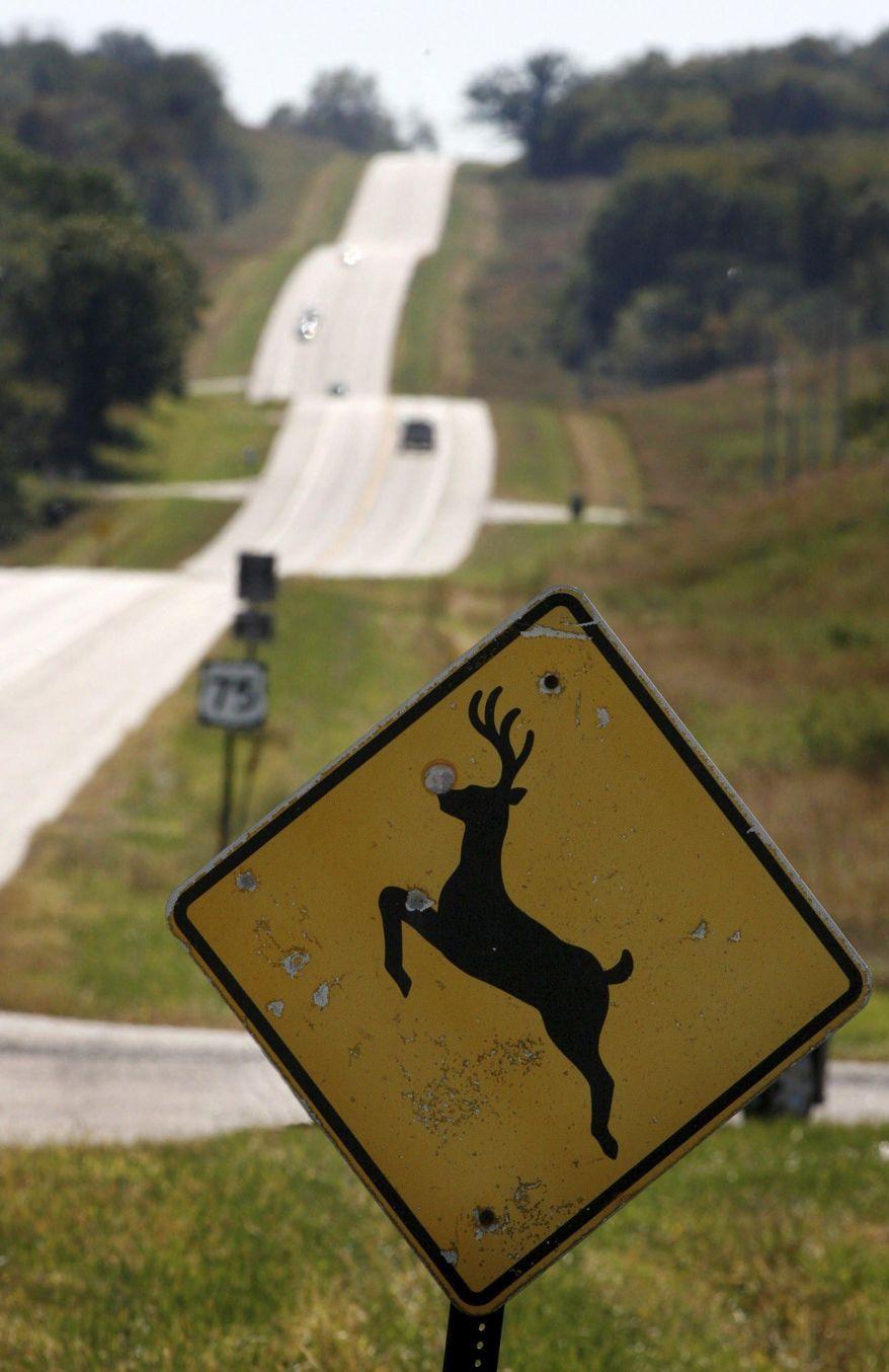 In this Oct. 8, 2007 photo, a deer crossing sign looks south on Highway 50 in Nebraska City, Neb. (Kent Sievers/Omaha World-Herald via AP)
