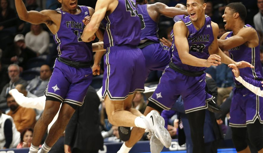 Furman guard Alex Hunter (10) and forward Clay Mounce (45) celebrate after their team defeated Villanova 76-68 in overtime in an NCAA college basketball game, Saturday, Nov. 17, 2018, in Villanova, Pa. (AP Photo/Laurence Kesterson)