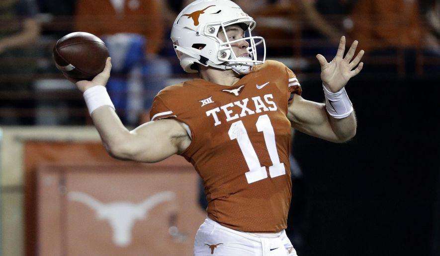 Texas quarterback Sam Ehlinger (11) throws against Iowa State during the first half of an NCAA college football game, Saturday, Nov. 17, 2018, in Austin, Texas. (AP Photo/Eric Gay)