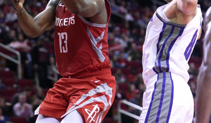 Houston Rockets guard James Harden, left, drives to the basket past Sacramento Kings guard Bogdan Bogdanovic during the second half of an NBA basketball game, Saturday, Nov. 17, 2018, in Houston. (AP Photo/Eric Christian Smith)