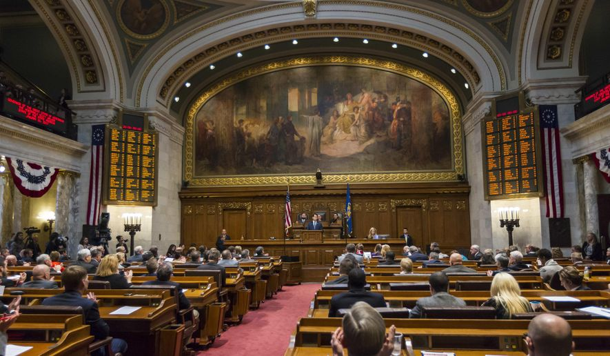 FILE - In this Jan. 10, 2017 file photo, Wisconsin Gov. Scott Walker addresses a joint session of the Legislature in the Assembly chambers at the state Capitol in Madison, Wis. Braced for a new era of divided government, lame-duck Republicans who have long controlled two upper Midwest states are priming last-ditch laws to advance their conservative agenda or to weaken the influence of Democratic governors-elect.The moves, which may spark lawsuits if they come to pass, would follow midterm elections in which Democrats swept statewide offices in Michigan and Wisconsin for the first time in decades but fell short of taking over gerrymandered legislatures.(AP Photo/Andy Manis File)