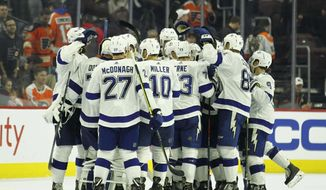 The Tampa Bay Lightning celebrate their overtime win in an NHL hockey game against the Philadelphia Flyers, Saturday, Nov. 17, 2018, in Philadelphia. The Lightning won 6-5. (AP Photo/Tom Mihalek)
