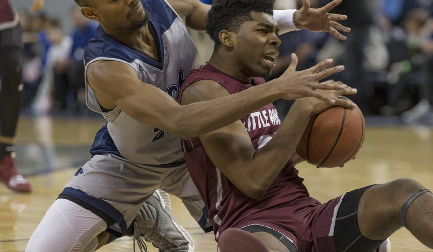 Nevada forward Jordan Brown, left, and Little Rock forward Kamani Johnson scramble for a loose ball during the first half of an NCAA college basketball game in Reno, Nev., Friday, Nov. 16, 2018. (AP Photo/Tom R. Smedes)