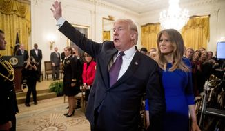 In this Nov. 16, 2018, photo, first lady Melania Trump walks with President Donald Trump as they leave a Medal of Freedom ceremony in the East Room of the White House in Washington, Friday, Nov. 16, 2018. (AP Photo/Andrew Harnik)