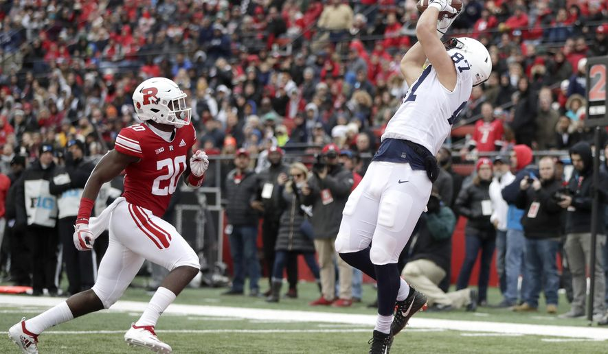 Penn State tight end Pat Freiermuth (87) catches a touchdown pass from quarterback Trace McSorley, not pictured, as Rutgers defensive back Avery Young (20) defends during the first half of an NCAA college football game, Saturday, Nov. 17, 2018, in Piscataway, N.J. (AP Photo/Julio Cortez)