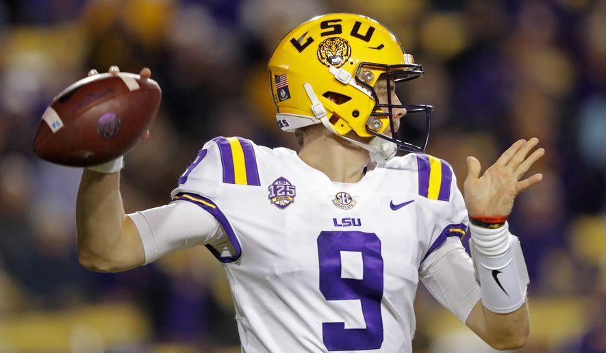 LSU quarterback Joe Burrow (9) passes in the first half of an NCAA college football game against Rice in Baton Rouge, La., Saturday, Nov. 17, 2018. (AP Photo/Gerald Herbert)